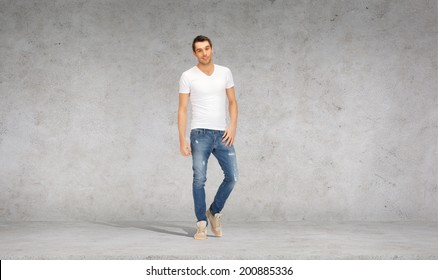 happiness, advertising and people concept - smiling young man in white t-shirt