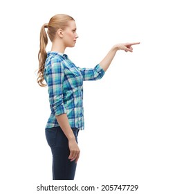 happiness, advertising and people concept - young woman pressing imaginary button
