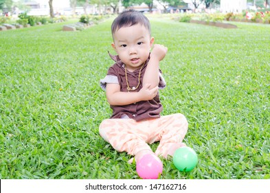 Happiness Asia Baby boy sitting on the grass in park