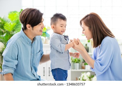 Happiness asian family - Young parent play with child happily at home
