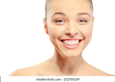 Happiness and Beauty. Portrait of Attractive Young laughing caucasian Woman looking at Camera. Isolated on White Background. Fresh Clean Skin