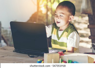happiness boy learning on laptop computer concept for education and using smart phone, internet, homework and social media