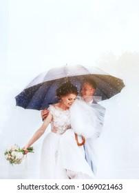 Happiness bride and groom under umbrella