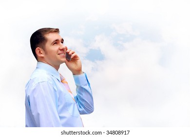 Happiness businessmen call by phone on sky with clouds background