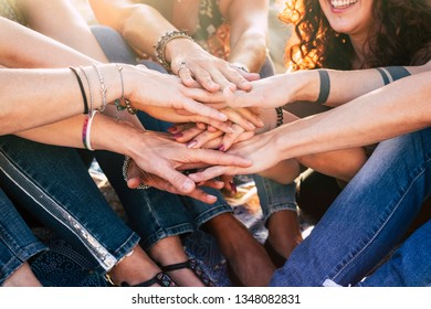 Happiness and cheerful lifestyle for team concept girls putting hands together for forever friends - happiness and friendship group of women smile and have fun with sun in backlight