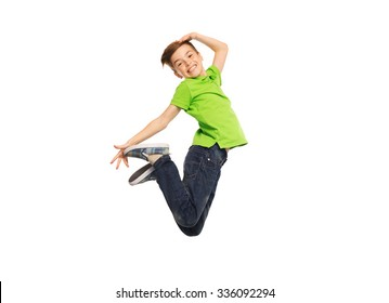 happiness, childhood, freedom, movement and people concept - smiling boy jumping in air