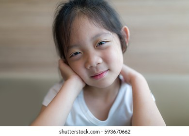 Happiness Concept Illustrated by Smiling Asian Child, Girl, Headshot