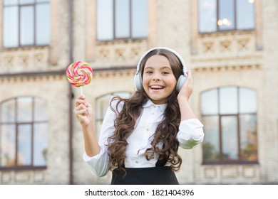 Happiness concept. Smiling pupil. Real success. Happy song. Leisure and rest. Happy kid outdoors. Cheerful schoolgirl. Schoolgirl listening music. Happy childhood concept. International childrens day.