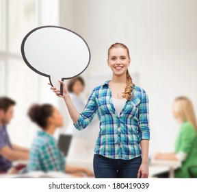 happiness, conversation and people concept - smiling young woman with blank text bubble