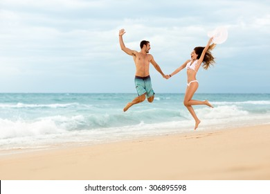 Happiness couple jumping on beach