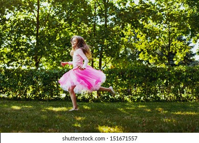 happiness, cute little girl running in the park