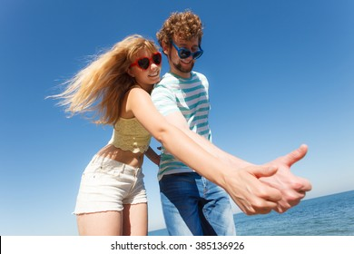 Happiness dating concept. Couple in love blonde woman bearded man enjoy date, making thumb up hand gesture outdoor, wide angle view