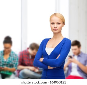 happiness, education and people concept - serious young woman in casual clothes