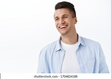 Happiness, family and emotions concept. Close-up portrait of handsome happy young man with stylish haircut, look away left empty space with pleased cheerful smile, laughing and rejoicing
