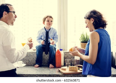 Happiness family having breakfast together