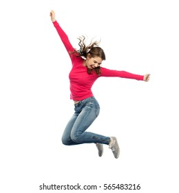 7a5de17735 happiness, freedom, motion and people concept - smiling young woman jumping  in air over