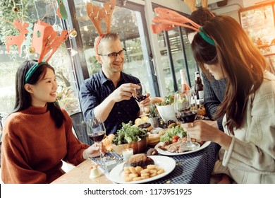 happiness friends christmas eve celebrate dinner party with food wine and laugh together with joyful moment