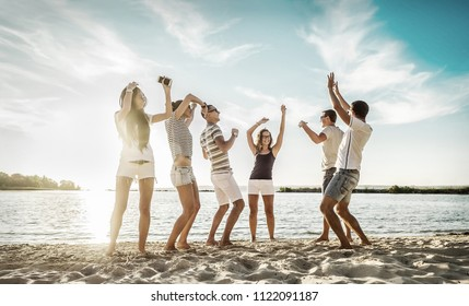 Happiness Friends funny dance on the beach under sunset sunlight in summer sunny day.