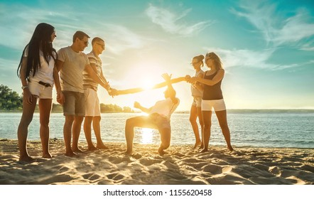 Happiness Friends funny game on the beach under sunset sunlight in summer sunny day.