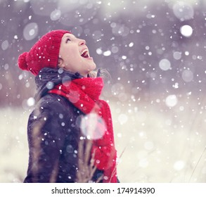 happiness, girl catches snowflakes mouth