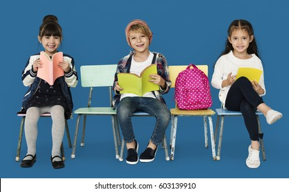 Happiness group of cute and adorable students reading book