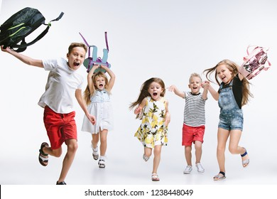 Happiness group of cute and adorable teen children or students are back to school. over white studio background. The friendship, education, childhood, kids fashion concept