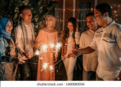 happiness lighting the takbir night fireworks with friends while celebrating the Eid holiday