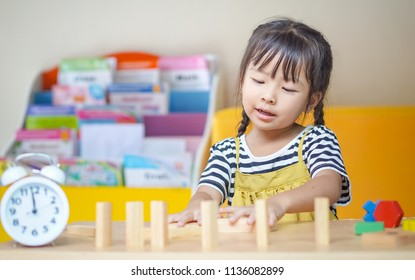 happiness little girl learning construction with wooden blocks or wood blocks stack game. concept education.