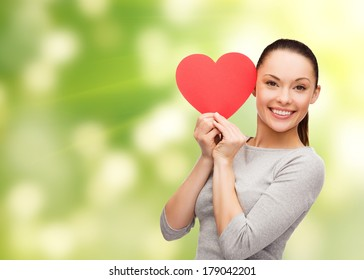 happiness, love and health concept - smiling asian woman with red heart