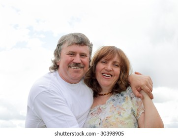 Happiness mature couple against the sky