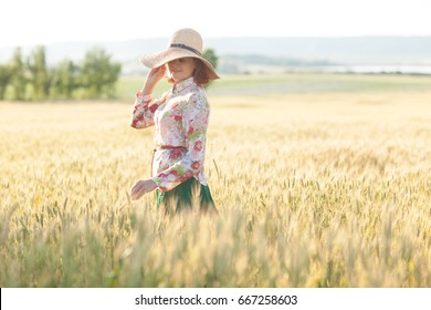 Happiness, Nature, Summer Holidays, Vacation and People Concept - Smiling 50 Years old  Woman in Hat