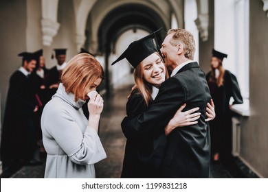 Happiness. Parents. Congratulations. Student. Finish Studies. University. Graduates. Happy. Good Mood. Have Fun. Architecture. Relations. Diploma. Standing. Corridor. Mother. Father. Daughter.