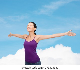 happiness and people concept - smiling girl in blank purple tank top waving hands with closed eyes