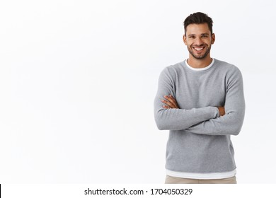 Happiness, people and men health concept. Attractive smiling caucasian guy with beard, wear grey sweater, cross arms chest in casual pose, laughing and gazing camera enthusiastic, chatting