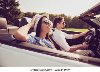 Happiness, reach destination, honeymoon, freedom, relationship, road, escape, speed ride lifestyle. Side profile view of carefree cheerful romantic married well dressed couple