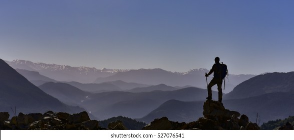 happiness and the struggle of climbing the mountain peak