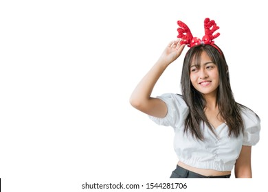 Happiness teenage girl wearing Christmas headband on a white background with copy space. Christmas and Happy New Year Concept.