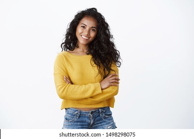 Happiness, wellbeing and confidence concept. Cheerful attractive african american woman curly haircut, cross arms chest in self-assured powerful pose, smiling determined, wear yellow sweater
