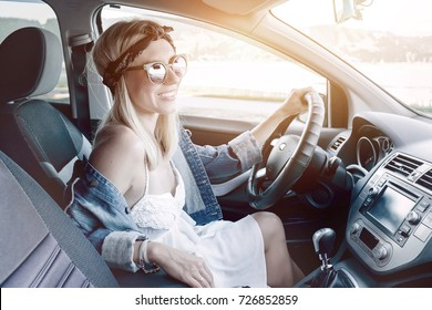 Happiness woman driving black car at sunny day