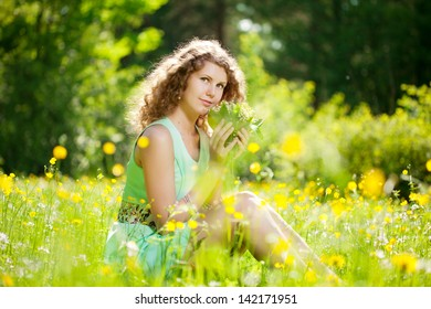 Happiness young beauty woman in field of flowers