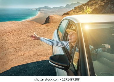 Happiness young woman in hat, sitting in her white car and look