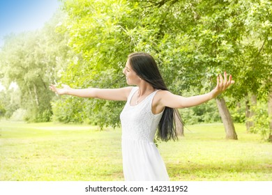 Happiness young woman with sprading hands enjoyment in the nature and beautiful day.