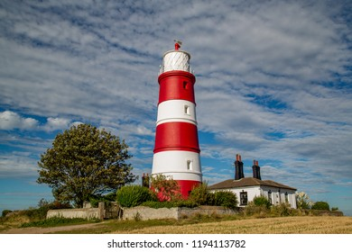 Happisburgh lighthouse situtated in Norfolk in beautiful autumnal sunshine, UK
