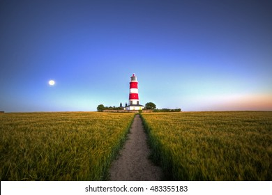 Happisburgh, Norfolk, UK, July 18 2016 - Showing Happisburgh lighthouse on the North Norfolk coast, used to light up the cliffs to provide safe passage to passing ships