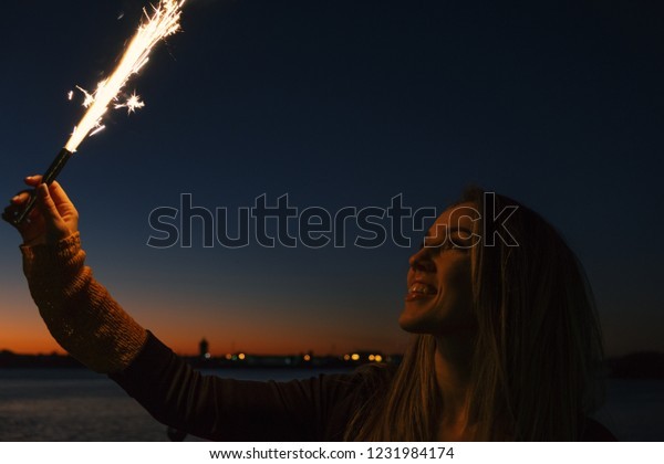 happpy-woman-holding-roman-candle-600w-1