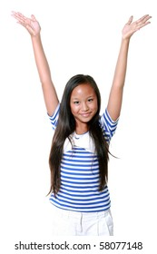Happy 10-year old asian girl with hands in the air, isolated on white background
