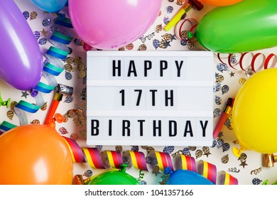 Happy 17th Birthday Celebration Message On A Lightbox With Balloons And Confetti