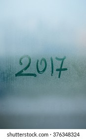 Happy 2017 New Year on window glass written text. abstract closeup texture