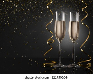 Happy 2019! Holiday champagne glasses and golden decorations, copy space