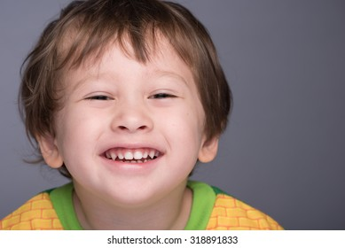 A happy 3 year old Japanese/Caucasian boy smiling.